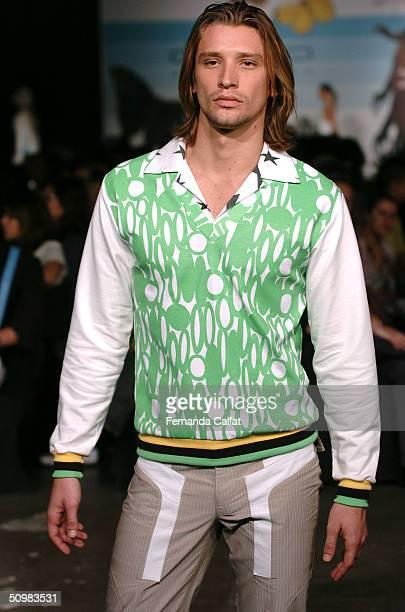 Model Alvaro Jacomossi walks the runway at the Sao Paulo Fashion Week Summer 2005 Custo Barcelona Fashion Show at the Fundacao Bienal de Sao Paulo...