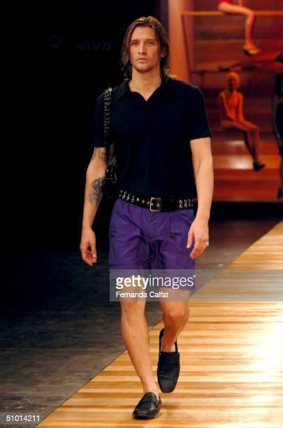Model Alvaro Jacomossi walks the runway at the Sao Paulo Fashion Week Uma 2004/2005 Uma Fashion Show at the Fundacao Bienal de Sao Paulo during the...