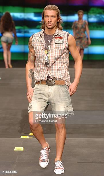 Model Alvaro Jacomossi wears a garment by Brazilian designer Colcci during the 2005 Spring/Summer collection Fashion Rio Summer 2005 in Rio de...