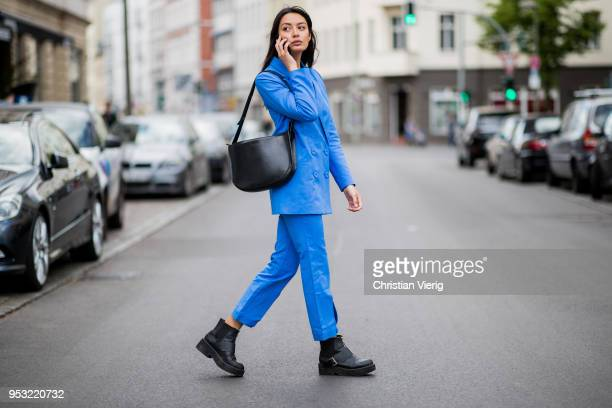 Model Alyssa Cordes wearing a blue Gestuz suit Asos boots Samsoe Samsoe bag seen on April 30 2018 in Berlin Germany