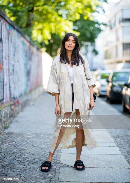 Model Alyssa Cordes wearing Gestuz kimono slipon Suicoke shoes black vintage leather shorts and white blouse black APC bag on June 6 2018 in Berlin...