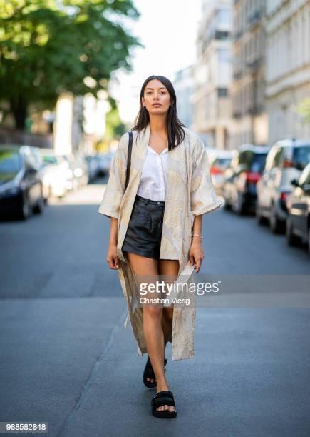 Model Alyssa Cordes wearing Gestuz kimono slipon Suicoke shoes black vintage leather shorts and white blouse black APC bag on June 6 2018 in Berlin...