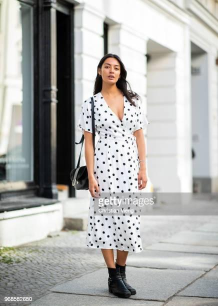 Model Alyssa Cordes wearing white dress with black dot print Gestuz the Kooples leather ankle boots APC bag wearing on June 6 2018 in Berlin Germany