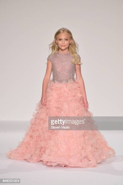 Model Alyvia Lind walks the runway at the Sherri Hill NYFW SS18 fashion show at Gotham Hall on September 12 2017 in New York City