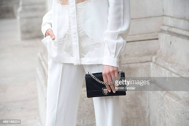Model Amalie Gassmann wears an Alexis Mabille shirt Zara pants and a Dior bag on day 4 of Paris Fashion Week Haute Couture Autumn/Winter 2015 on July...