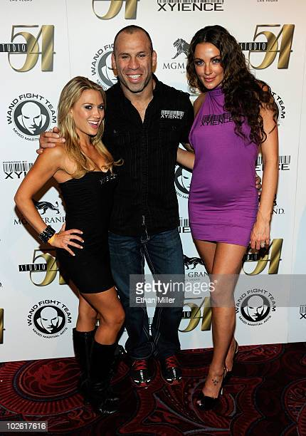 Model Amanda Corey mixed martial artist Wanderlei Silva and model Amber Nichole arrive at Silva's 34th birthday celebration and postfight party for...