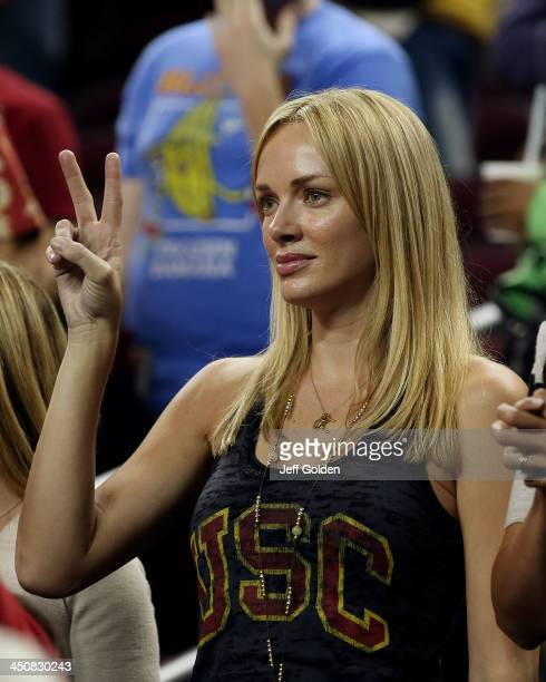 Model Amanda Enfield makes a V for victory hand gesture after the home opening game between the Cal State Northridge Matadors and the USC Trojans at...