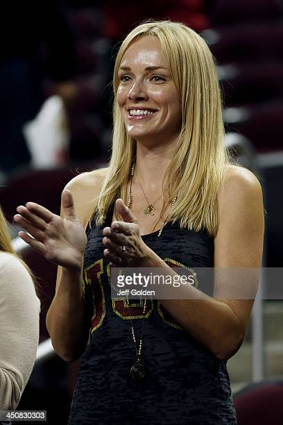 Model Amanda Enfield smiles as she applauds the victory after the home opening game between the Cal State Northridge Matadors and the USC Trojans at...