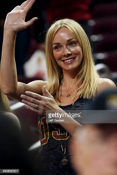 Model Amanda Enfield smiles as she waves to her husband after the home opening victory in the game between the Cal State Northridge Matadors and the...