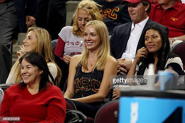 Model Amanda Enfield smiles at her seat during the second half of the home opening game between the Cal State Northridge Matadors and the USC Trojans...
