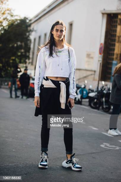 Model Amanda Googe wears a Wasted PAris hallucinate shirt black jeans and Louis Vuitton Arclight sneakers after the Haider Ackermann show during...