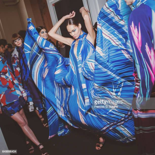 Model Amanda Harvey poses backstage before the Leonard Paris show as part of the Paris Fashion Week Womenswear Fall/Winter 2017/2018 on March 6, 2017...