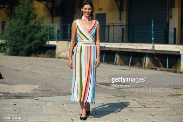 Model Amanda Murphy wears a colorful striped dress after the Roberto Cavalli show during Milan Fashion Week Spring/Summer 2019 on September 22 2018...