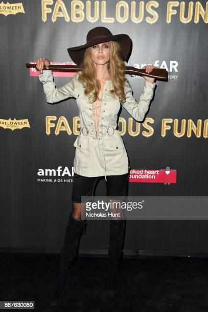 Model Amanda Wellsh attends the 2017 amfAR The Naked Heart Foundation Fabulous Fund Fair at Skylight Clarkson Sq on October 28 2017 in New York City