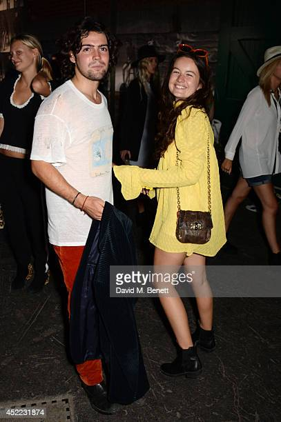 Model Amba Jackson and guest attend the PUMA x McQ debut AW14 collection launch at Factory 7 on July 16 2014 in London England