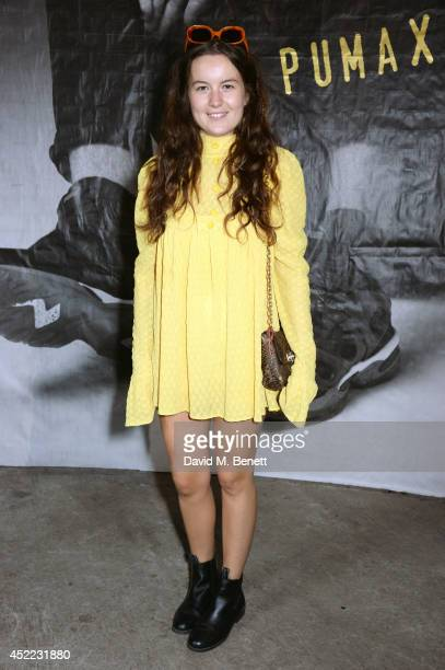 Model Amba Jackson attends the PUMA x McQ debut AW14 collection launch at Factory 7 on July 16 2014 in London England