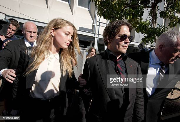 Model Amber Heard and her husband Johnny Depp leave Southport Magistrates Court Queensland April 18 2016 Heard received a fine for bringing pet dogs...