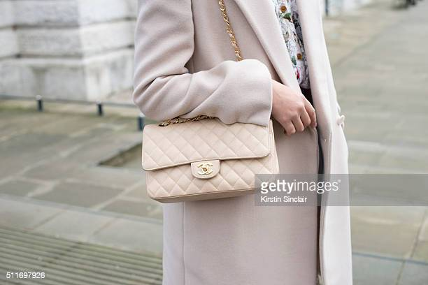 Model Amber Le Bon wears a Stella McCartney coat and Chanel bag on day 3 during London Fashion Week Autumn/Winter 2016/17 on February 21 2016 in...