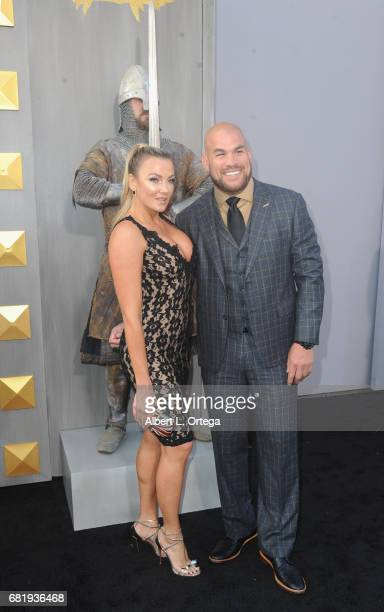 Model Amber Nichole Miller and fighter Tito Ortiz arrive for the Premiere Of Warner Bros Pictures' King Arthur Legend Of The Sword held at TCL...