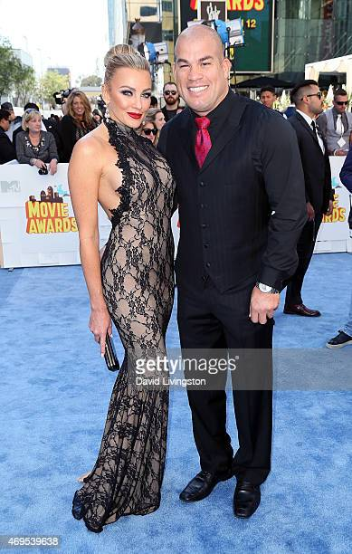 Model Amber Nichole Miller and mixed marial artist Tito Ortiz attend the 2015 MTV Movie Awards at the Nokia Theatre LA Live on April 12 2015 in Los...