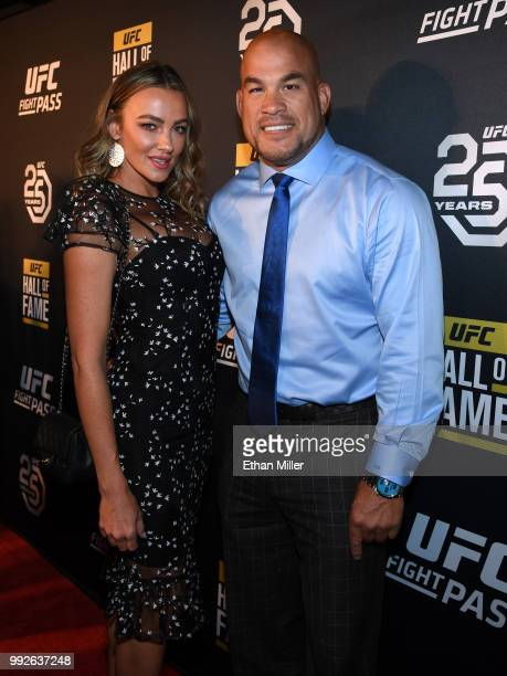 Model Amber Nichole Miller and mixed martial artist Tito Ortiz arrive at the UFC Hall of Fame's class of 2018 induction ceremony at Palms Casino...