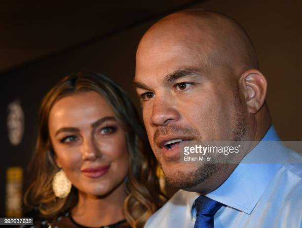 Model Amber Nichole Miller looks on as mixed martial artist Tito Ortiz is interviewed at the UFC Hall of Fame's class of 2018 induction ceremony at...