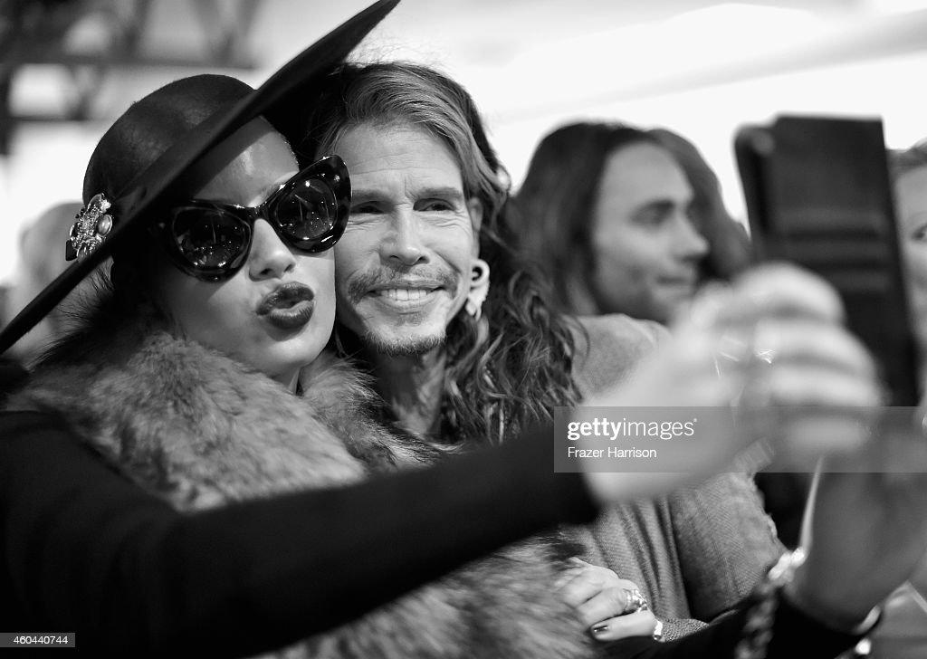 Model Amber Rose (L) and musician Steven Tyler attend TASCHEN And David Bailey Celebrate 'It's Just A Shot Away: The Rolling Stones In Photographs' at the TASCHEN Gallery on December 13, 2014 in Los Angeles, California.