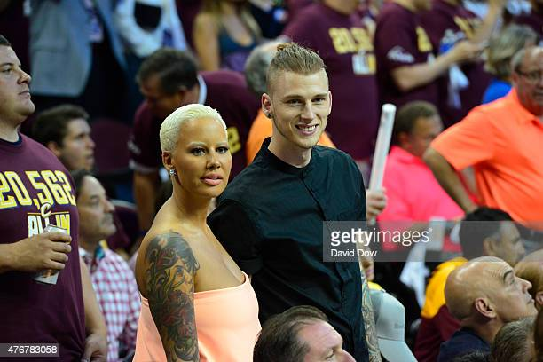 Model Amber Rose and Rapper, Machine Gun Kelly takes in the game of the Golden State Warriors against the Cleveland Cavaliers in Game Four of the...
