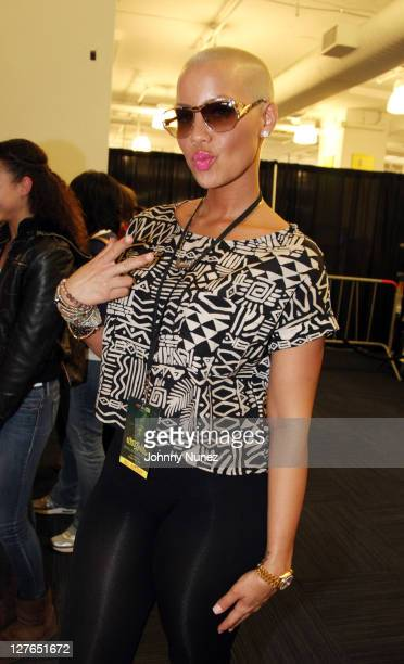 """Model Amber Rose attends the in-store event for Wiz Khalifa's new album """"Rolling Papers"""" at Best Buy on March 29, 2011 in New York City."""