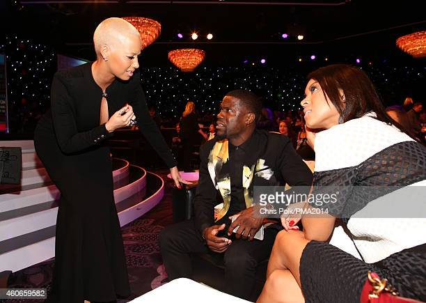 Model Amber Rose comedian Kevin Hart and Eniko Parrish attend the PEOPLE Magazine Awards at The Beverly Hilton Hotel on December 18 2014 in Beverly...