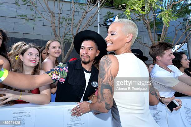 Model Amber Rose poses for a selfie photo with fans attending The 2015 MTV Movie Awards at Nokia Theatre LA Live on April 12 2015 in Los Angeles...