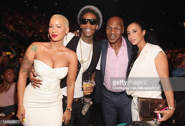 Model Amber Rose rapper Wiz Khalifa Mike Tyson and Lakiha 'Kiki' Tyson attend the 2012 Billboard Music Awards held at the MGM Grand Garden Arena on...