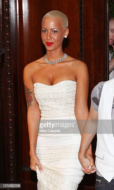 Model Amber Rose walks the runway at Celestino by Sergio Guadarrama Spring 2010 at the Ukrainian Institute Of America on September 14 2009 in New...
