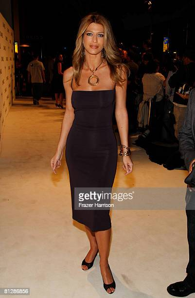 Model Amber Smith arrives at the opening of the Chanel boutique on Robertson Boulevard on May 29 2008 in Beverly Hills California