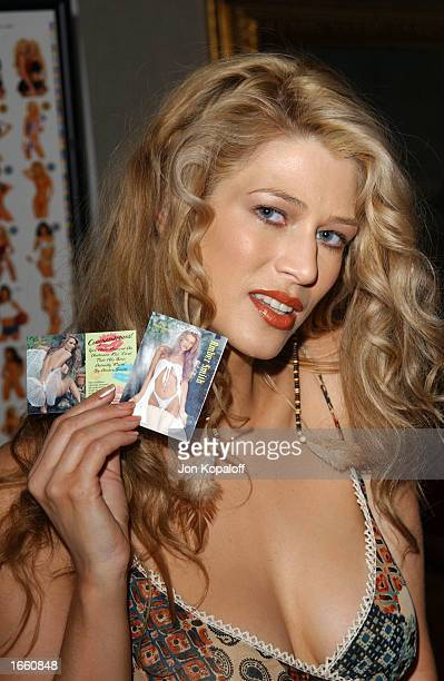 Model Amber Smith helps launch 'The Bench Warmer Trading Cards' 2002 Series' by signing her collectible trading cards at The Bel Age Hotel on...