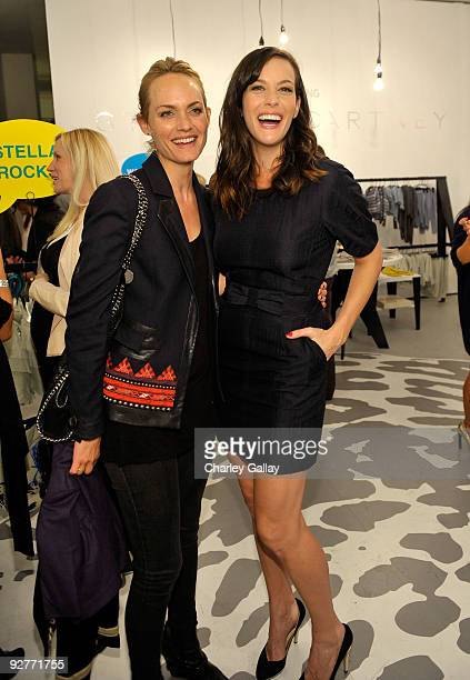 Model Amber Valletta and actress Liv Tyler attend the Stella McCartney for GapKids Pop Up Store event on November 4 2009 in Beverly Hills California