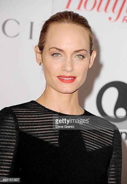 Model Amber Valletta attends The Hollywood Reporter's 22nd annual Women In Entertainment Breakfast Honoring Oprah Winfrey at Beverly Hills Hotel on...