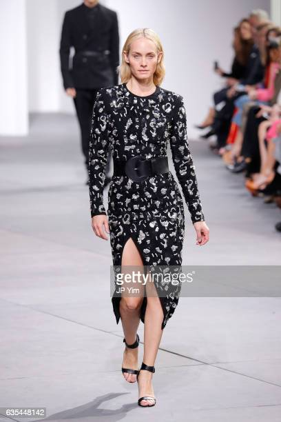 Model Amber Valletta walks the runway during the Michael Kors Collection Fall 2017 fashion show at Spring Studios on February 15 2017 in New York City