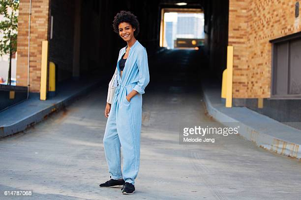 Model Amelia Rami wears a light blue jumpsuit over a black sport sbra and black sneakers after the 31 Phillip Lim show at Skylight Clarkson Square on...