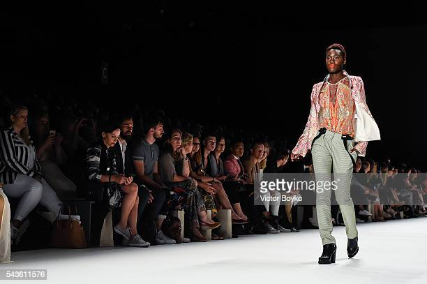 Model Aminata Sanogo walks the runway at the Anja Gockel show during the MercedesBenz Fashion Week Berlin Spring/Summer 2017 at Erika Hess Eisstadion...