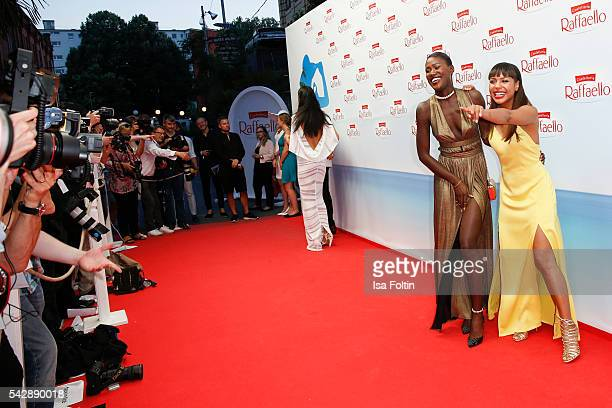 Model Aminata Sanogo wearing a dress designed by Marcel von Berlin and moderator Alexandra Maurer wearing a dress designed by Marcel von Berlin...