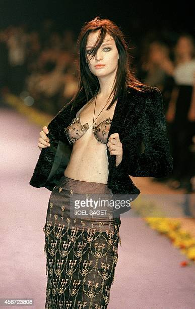 Model Amy Wesson shows off 11 March a black jacket worn over a transparent bra assorted with her skirt during the presentation of Chloe's readytowear...