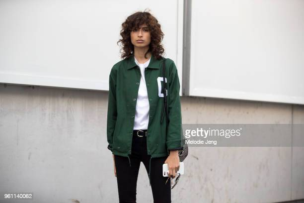 Model Ana Arto wears a green varsity shirt with a C during New York Fashion Week Spring/Summer 2018 on September 11 2017 in New York City
