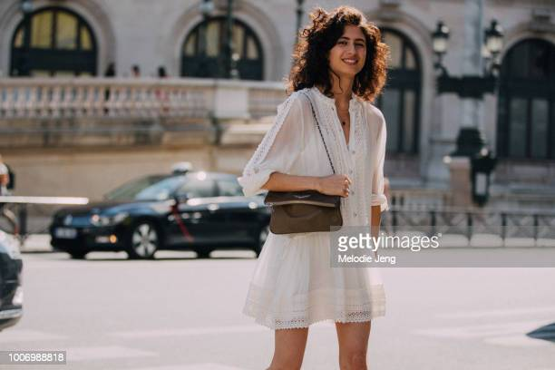 Model Ana Arto wears a white lace Kooples dress during Couture Fall/Winter 2018 Fashion Week on July 1, 2018 in Paris, France.