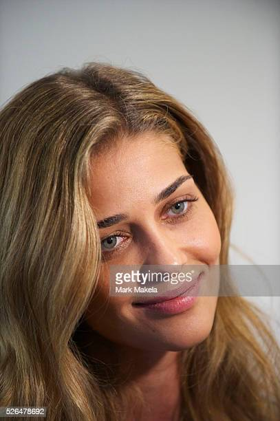 Model Ana Beatriz Barros poses for a photograph backstage before the Matthew Williamson autumn 2011 collection at Phillips de Pury Gallery in London...