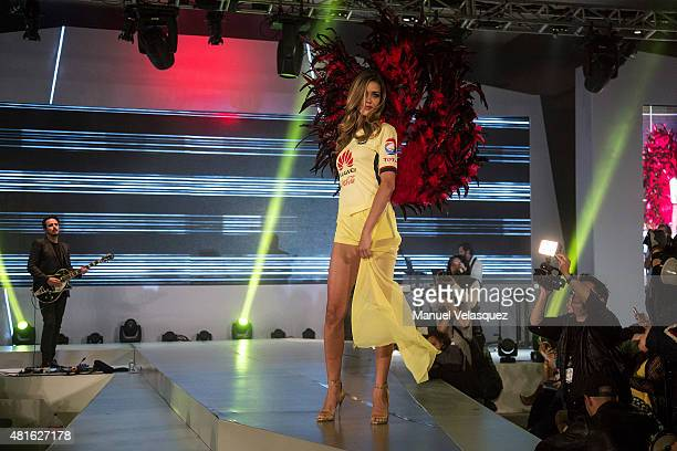 Model Ana Beatriz Barros walks the runway during the announcement of new Club America sponsor Huawei on July 22 2015 in Mexico City Mexico