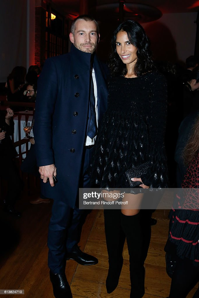 Model Ana Carolina Reis and her husband Yvan Reis attend Azzedine Alaia presents his new Perfume 'Alaia Eau de Parfum Blanche'. Held at Azzedine Alaia Gallery on October 10, 2016 in Paris, France.
