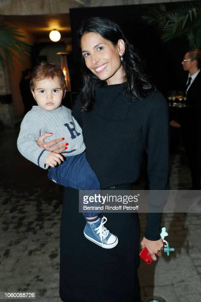 Model Ana Carolina Reis and her son Luka attend Alaia Foundation Library Opening at Gallery Azzedine Alaia on November 10 2018 in Paris France