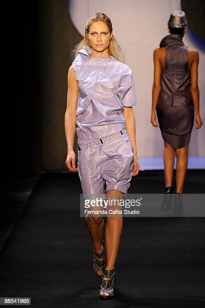 Model Ana Claudia Michels displays a design by Priscilla Darolt during the first day of Sao Paulo Fashion Week SpringSummer 2010 collection at the...