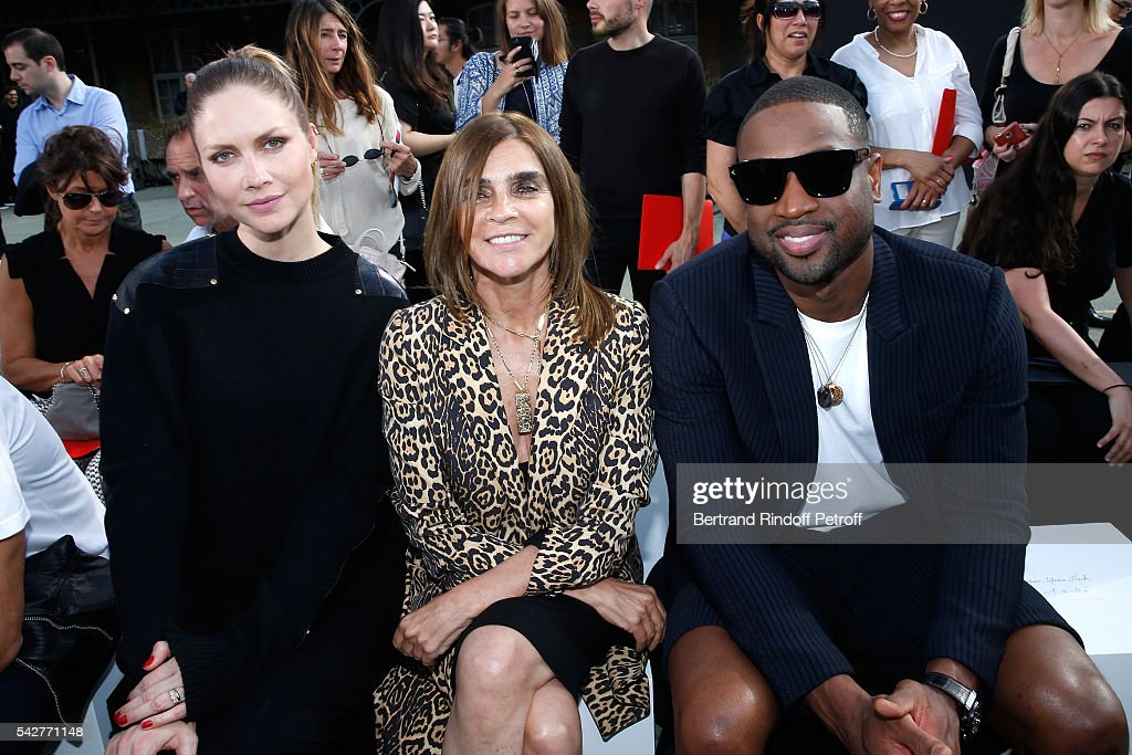 Model Ana Claudia Michels, journalist Carine Roitfeld and basket-ball player Dwyane Wade attend the Givenchy Menswear Spring/Summer 2017 show as part of Paris Fashion Week on June 24, 2016 in Paris, France.